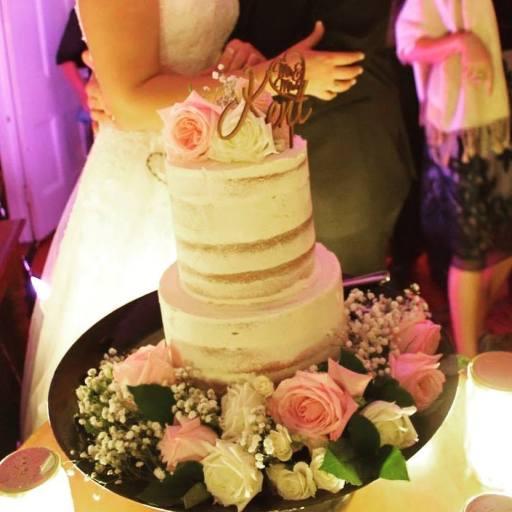 Semi naked cake with fresh flowers (photo provided bu the bride)