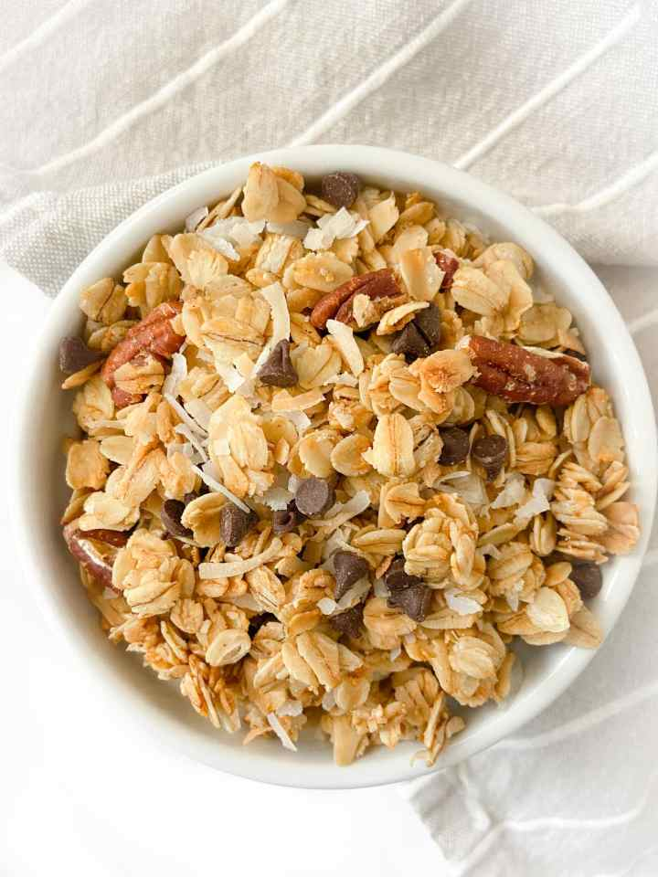 a bowl of coconut chocolate chip granola
