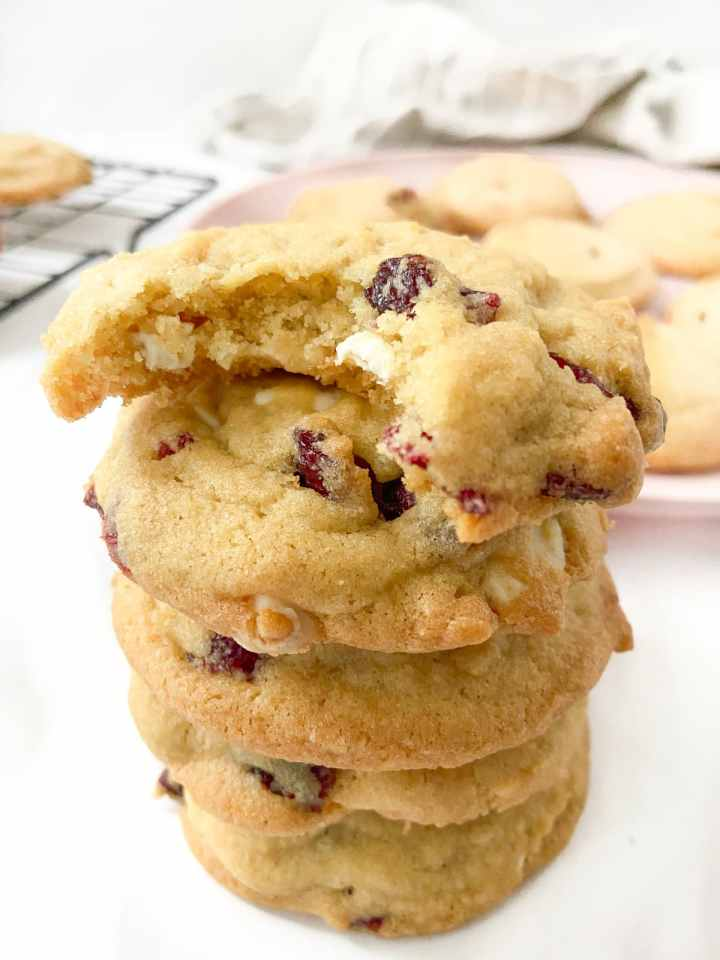 a stack of white chocolate cranberry cookies