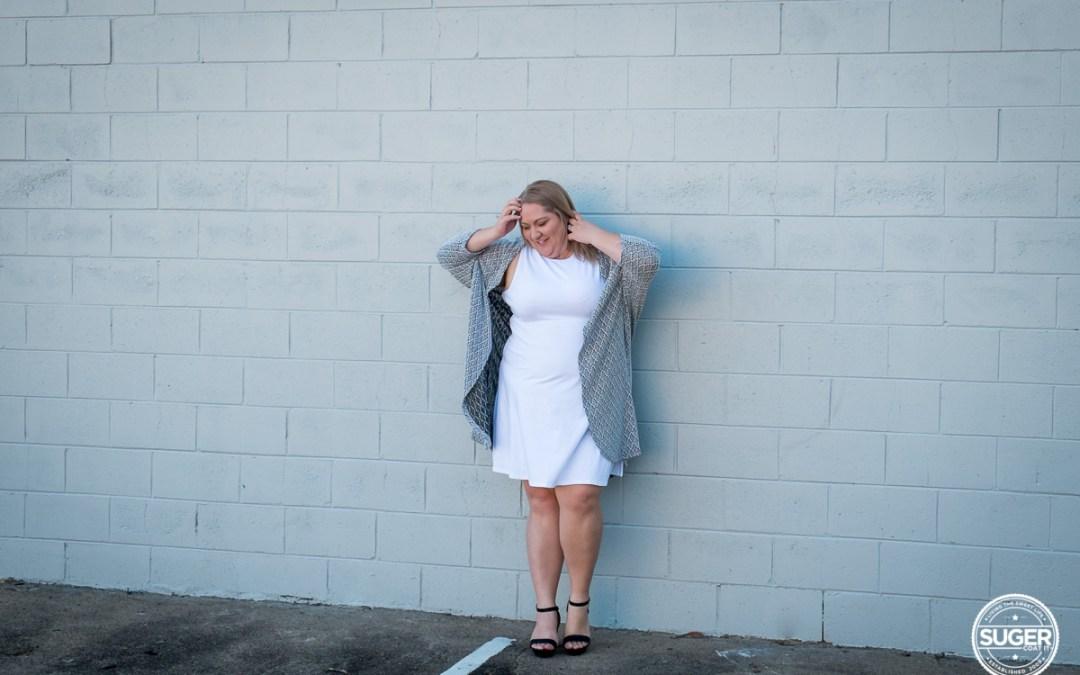 Winning in a simple white dress