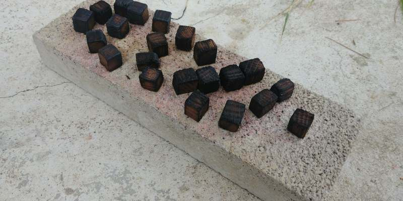 charring oak cubes with a torch