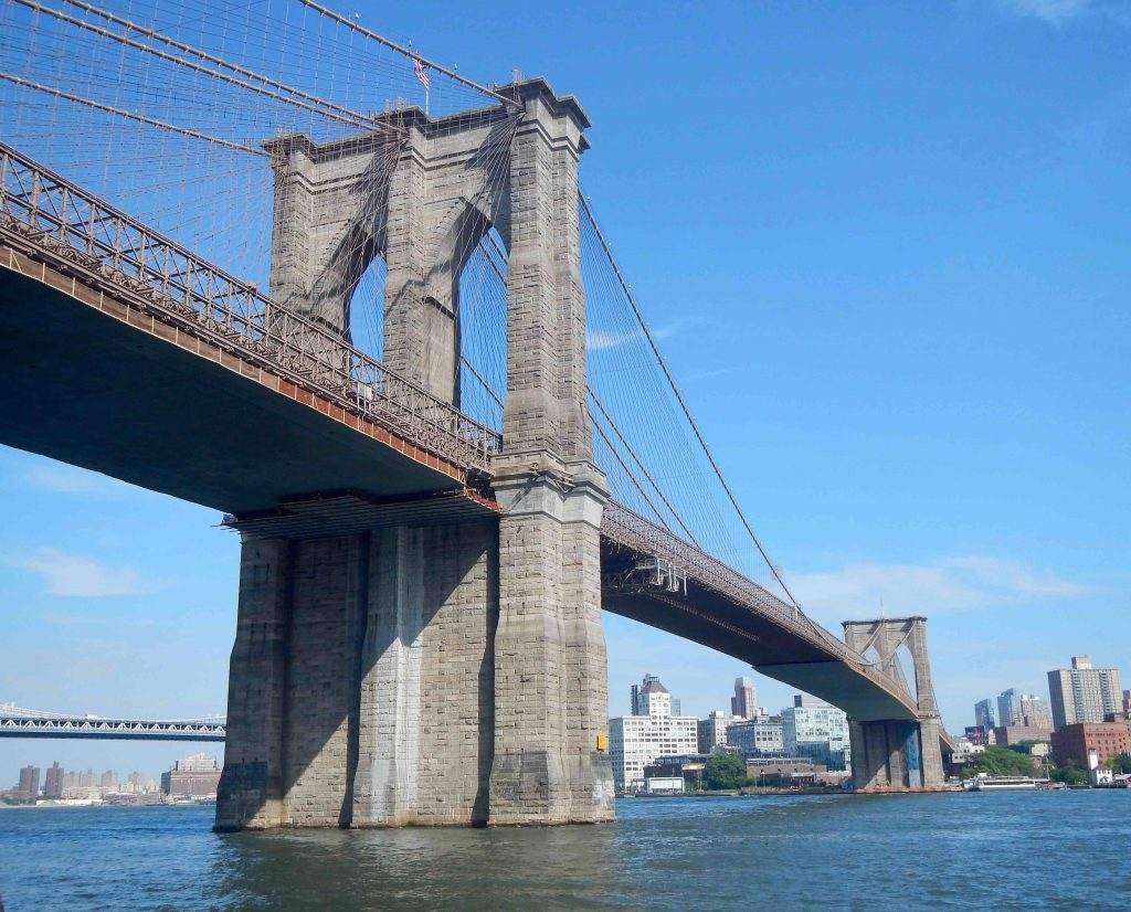 Beautiful view of the Brooklyn Bridge riding around the East River.