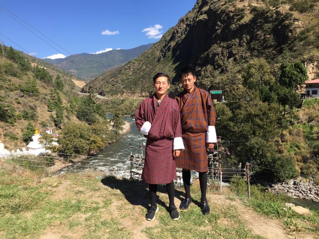 Our guide, Tenzin and driver, Passang, in traditional Bhutanese national dress.