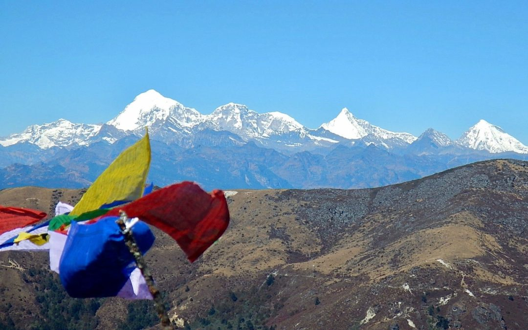 Prayer flags and the snow-capped mountains of Bhutan.