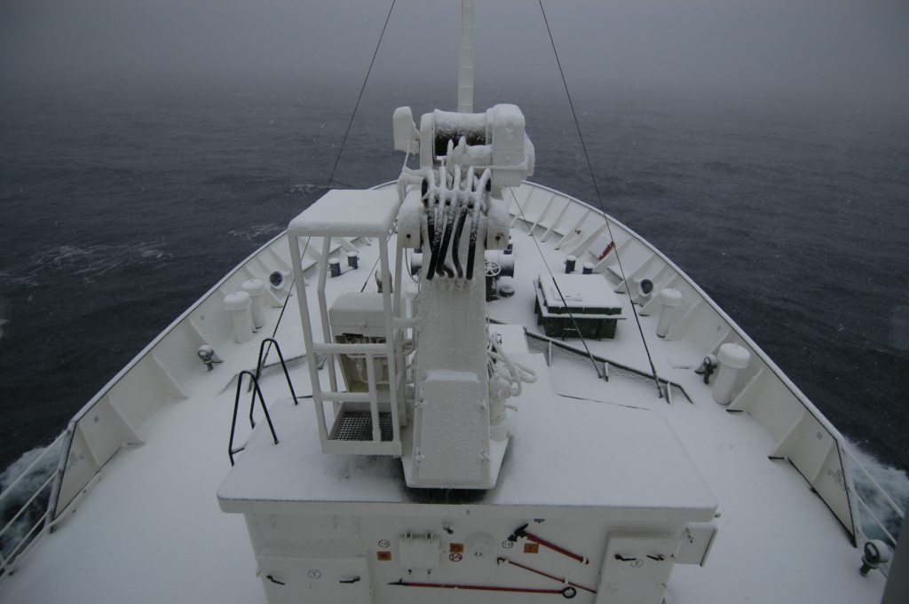 Cold, grey and bleak with snow covering the ship's deck in Antarctica.
