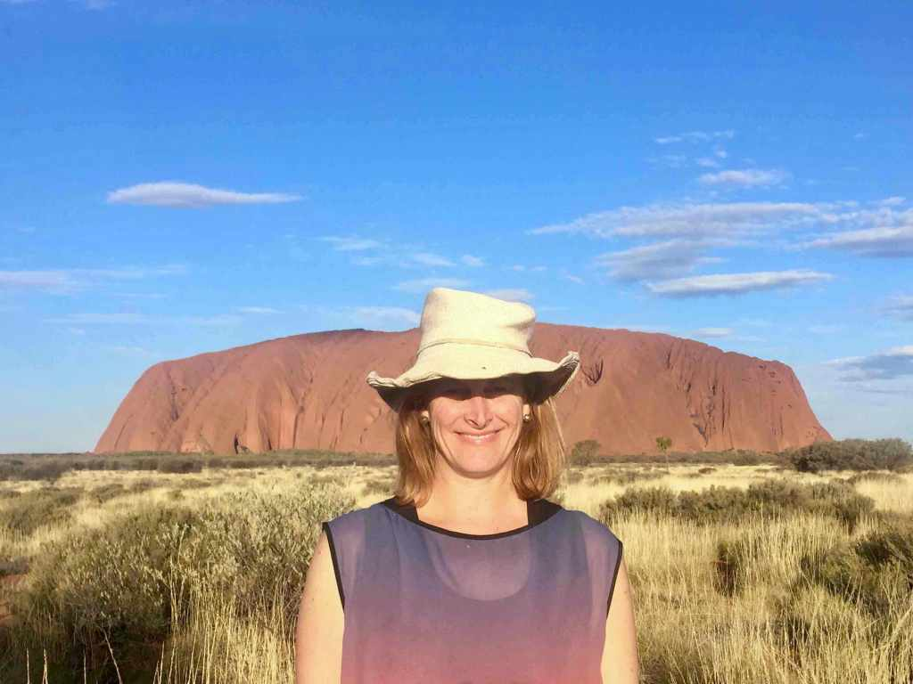 Best travel accessory - wearing my favourite travel hat at Uluru.