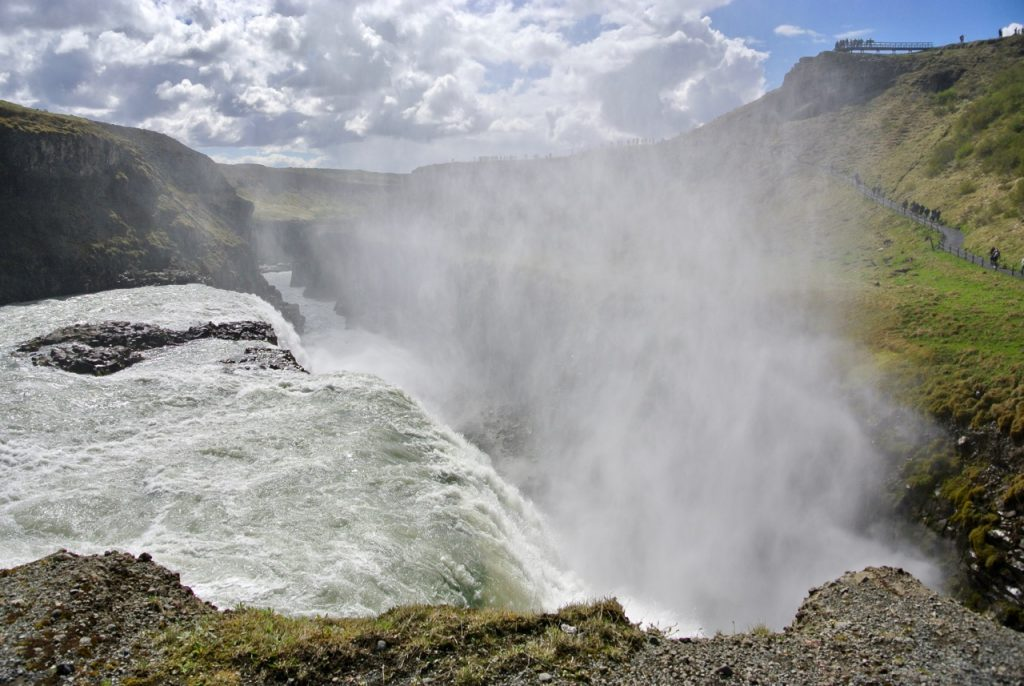 At Gullfoss the water falls down a deep, narrow crevasse.