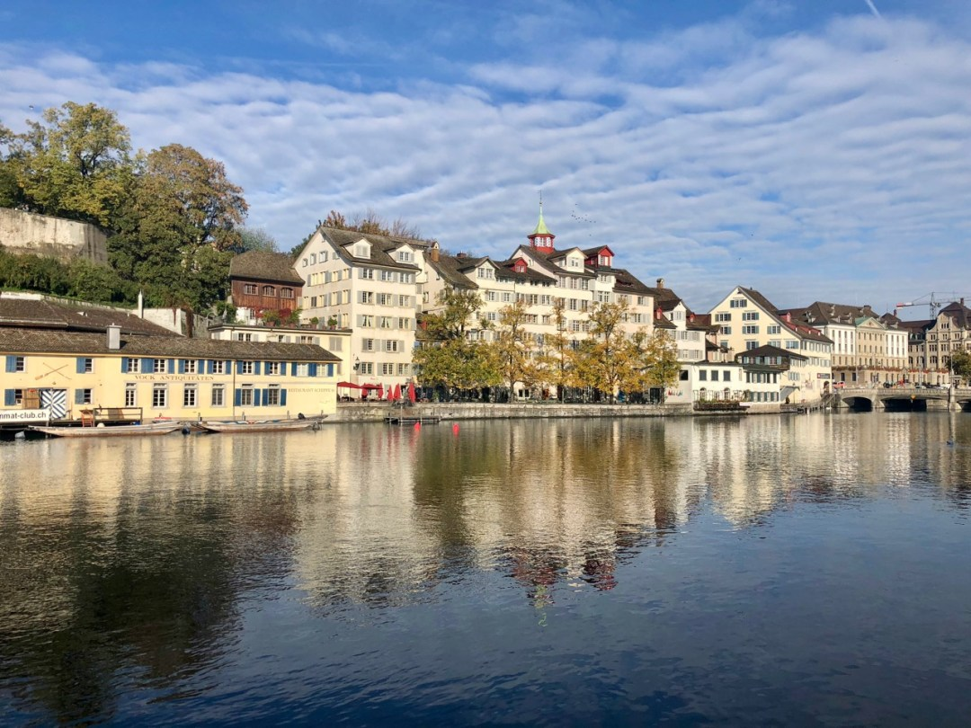 Buildings reflected onto Lake Zurich