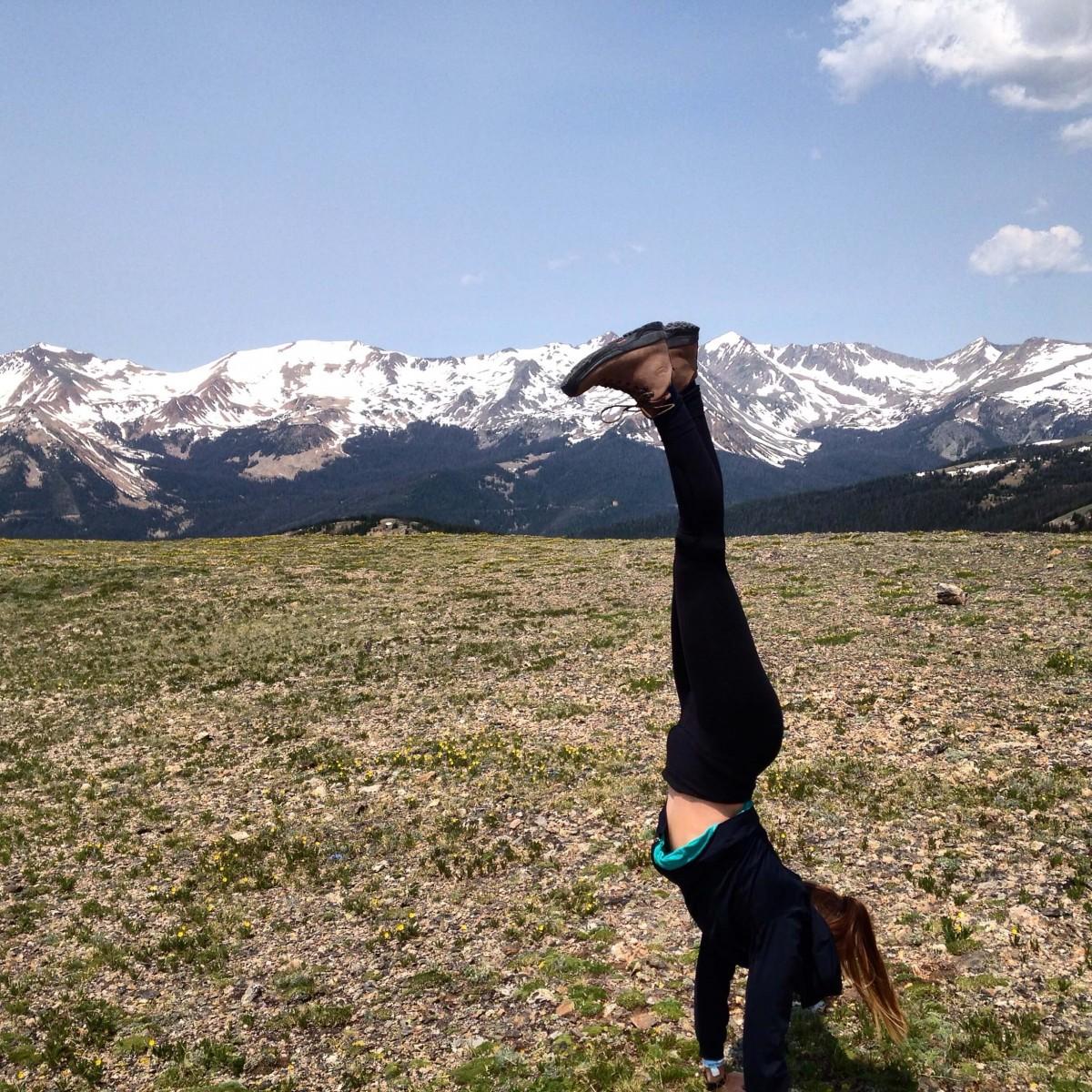 Sarah doing a handstand on Mt Ida