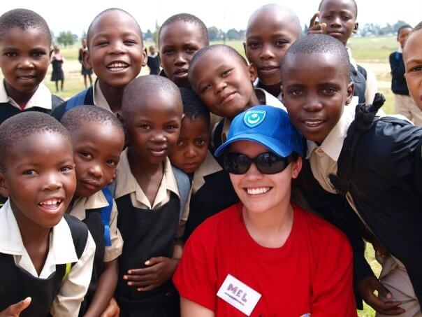 Melanie with students from a classroom in Africa.