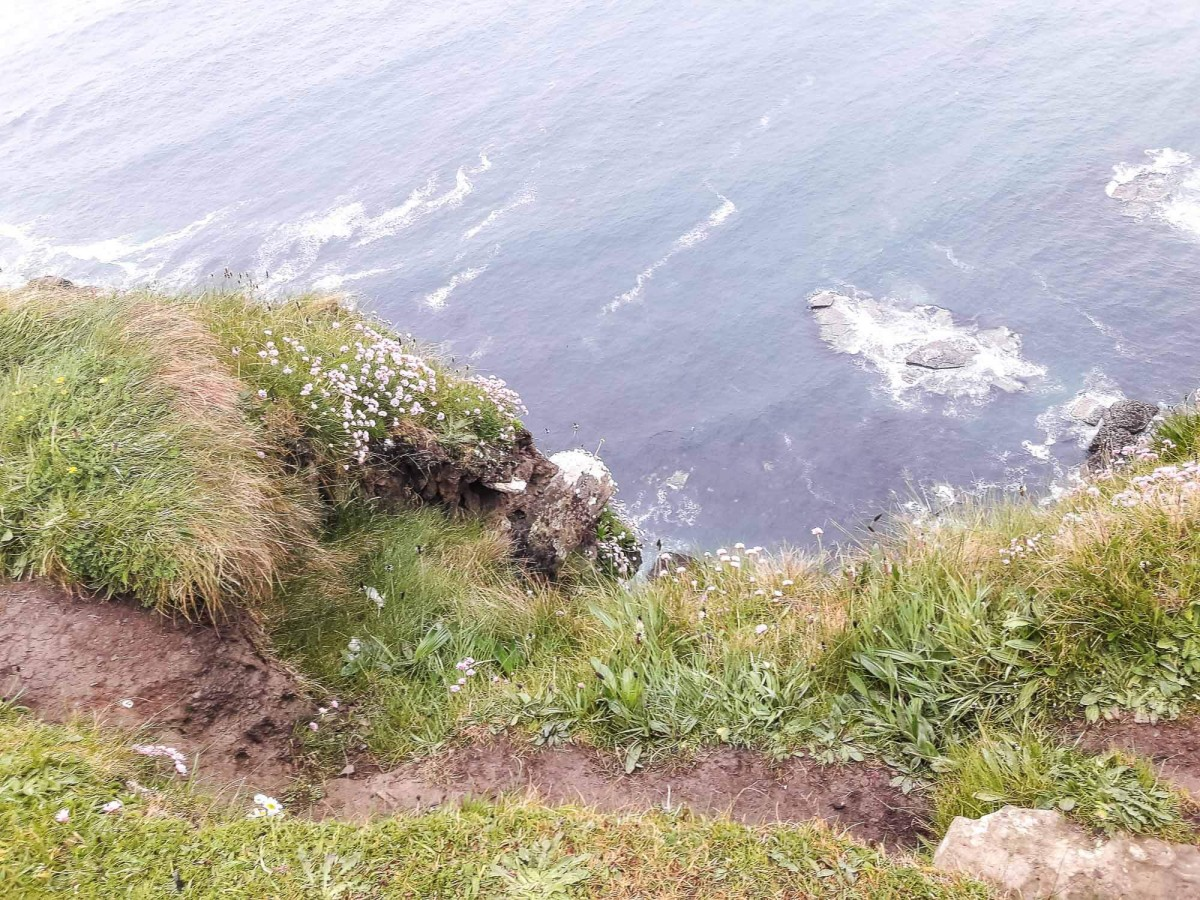 The thin dirt path on the edge of the Cliffs of Moher
