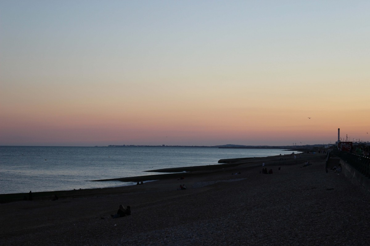 Photo at sunset of the beach in Brighton, England.