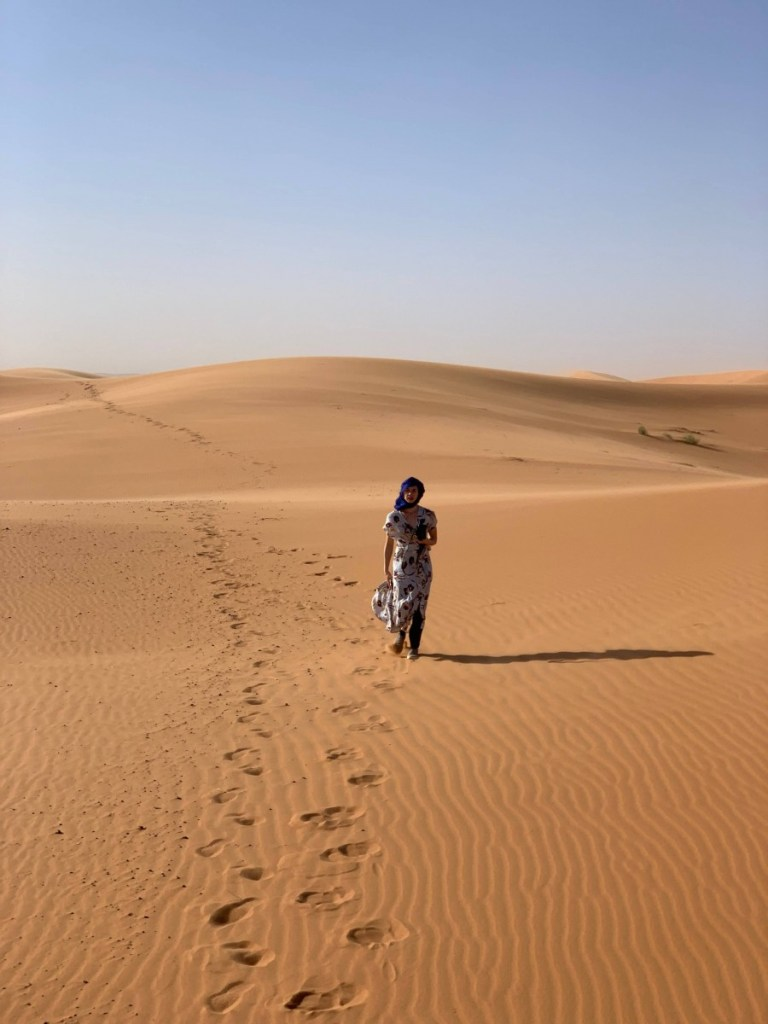 Suitcase Six walking-in-dunes-768x1024 How I Lost And Found My Phone in the Sahara Desert