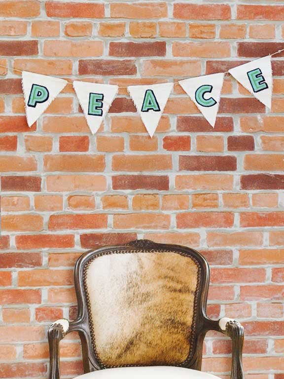 Embroidered Peace Bunting and Russell Chair