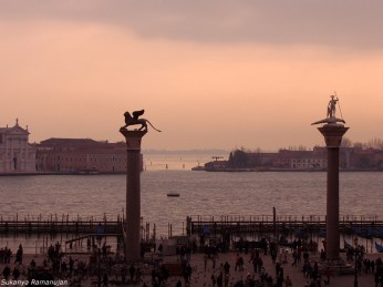 Venice- A winged lion and a saint in City