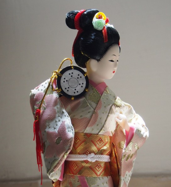 Geisha Doll from the left
