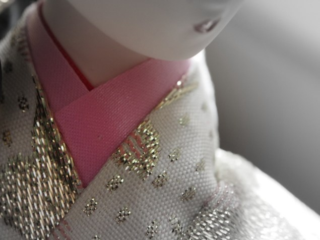 Detail of garment folds and the glitter