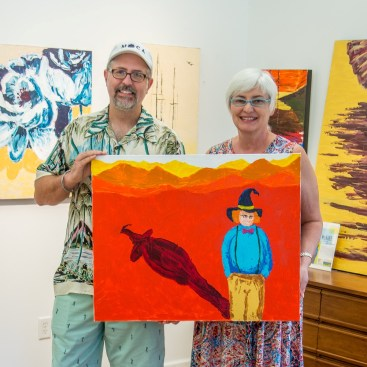 Susan and Corey C. McNabb holding portrait of fictional Nathan Waller