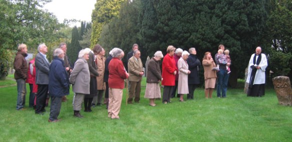 Parishioners gather under the renovated clock