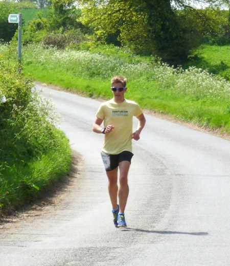 The second runner to pass through the village. Photo: Peter Mackness