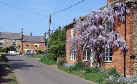 """""""If Winter's here, can Spring be far behind?"""" Wisteria Cottage in April"""