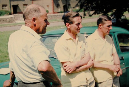 Left to right: Reg Butcher, Harold Wootton, Sandy Munro. On village green at start of a car rally in the early 1960s.