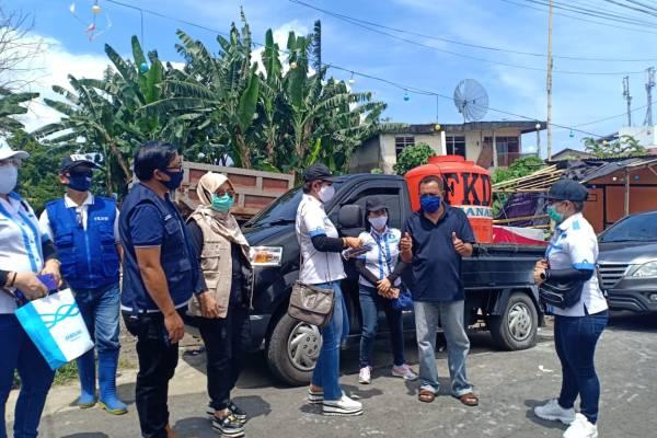 Penuhi Permintaan Warga, FKDM Dipimpin James Karinda Lakukan Penyemprotan di Daerah Zona Merah