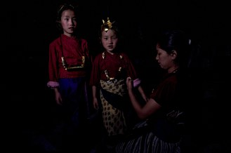 Children wear traditional dresses on these special occasions to perform local dance.