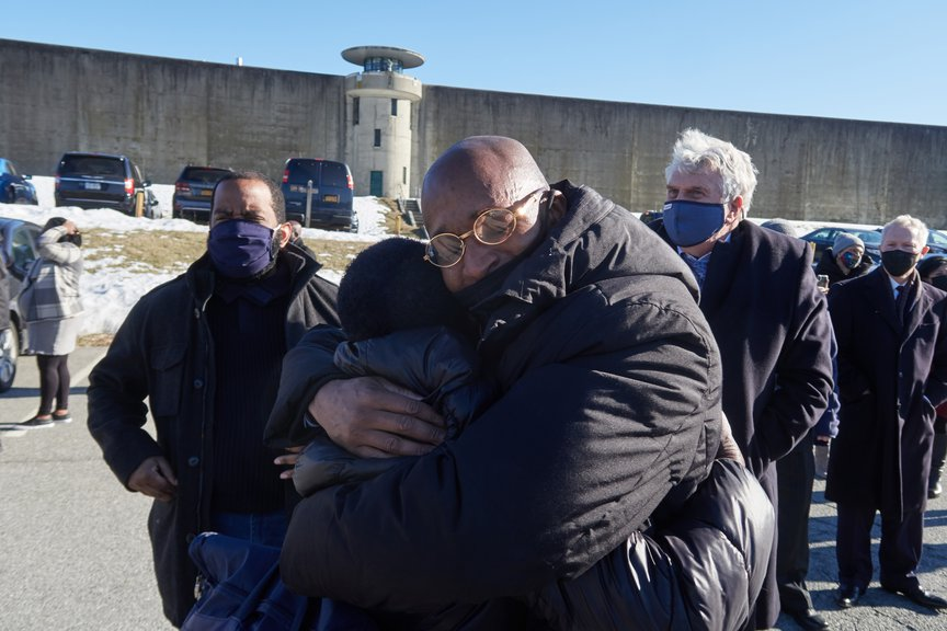George Bell embraces his family after walking out of prison.