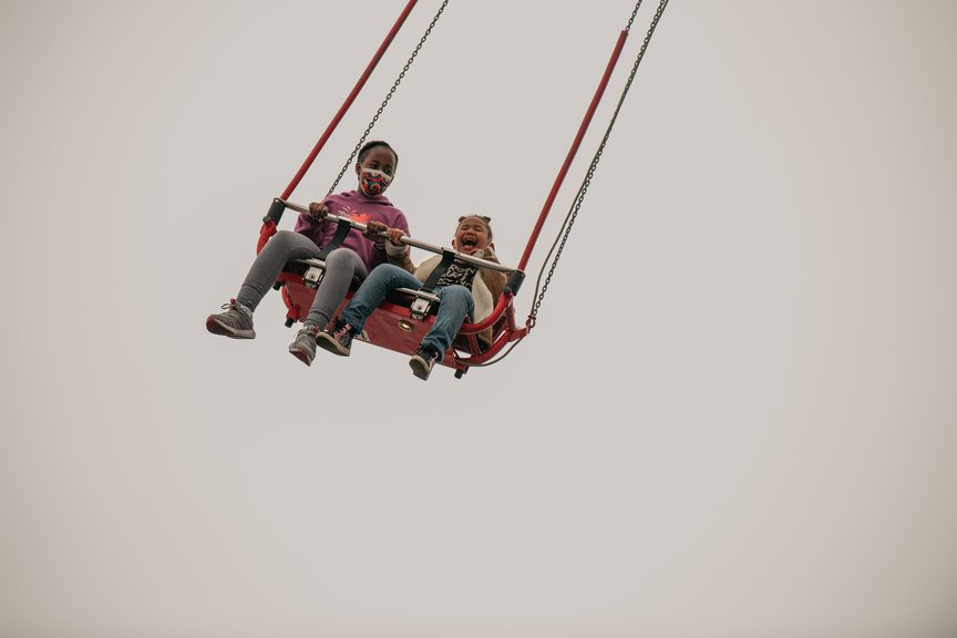 A photo of kids on a ride at Coney Island on April 9th, 2021