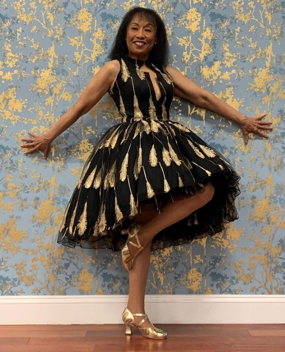 Baayork Lee models her LaDuca shoe in a gown by Malon Breton.