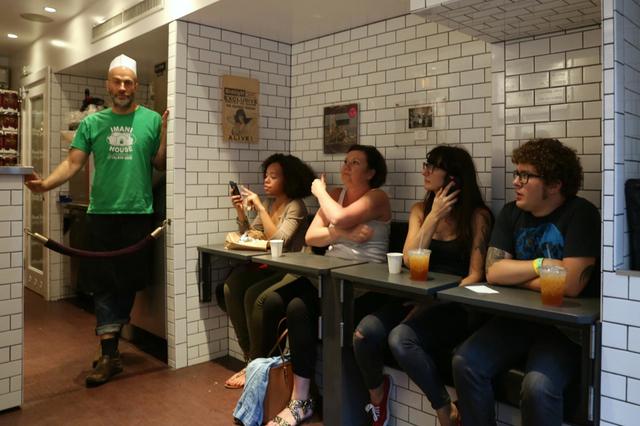 Diners crammed together at Superiority Burger