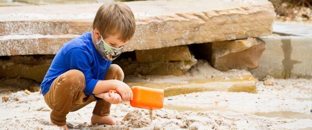 A camper digging at Earth Moves