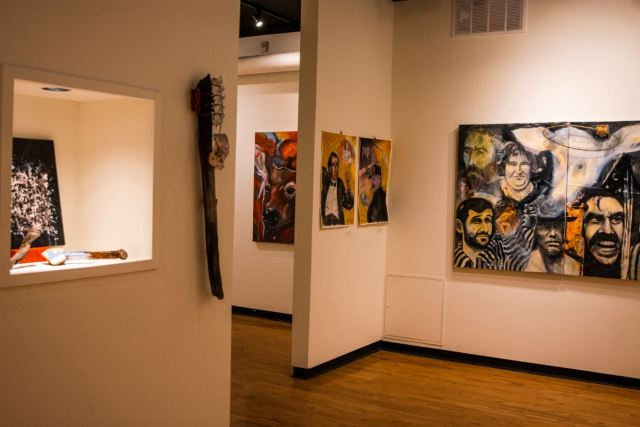 A view of many pieces including Baken's clubs and other paintings and mixed-media pieces