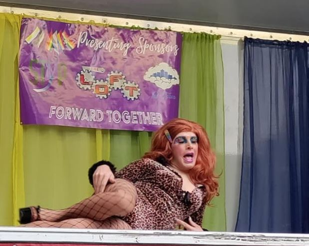 """This drag queen takes a moment to relaxingly strike a pose during her """"Feel Like A Woman"""" performance, where she would flip her hair, kick off her heels, and make her rounds through the crowd"""
