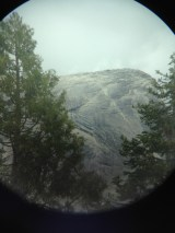 Half Dome as seen through an iPhone through a pair of binoculars. Notice the people on the cables.