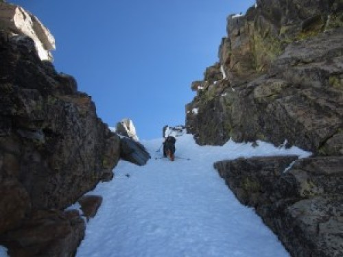 Boot descent of a couloir to cross over the North Ridge of Pyramid Peak