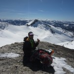 summit of Mt. Agassiz with Pat eating pizza