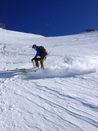 Ben Pope throws up a lot of snow while making a turn
