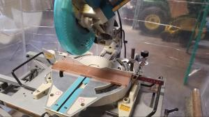 Miter saw taking the first cut on some poplar wood for Summitier's new project