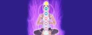 girl meditating with chakras along her spine