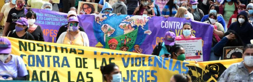 People holding signs march in Honduras.