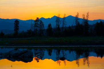 Smoke from distant wildfires tinges this summer sunrise in Frisco,Colorado.