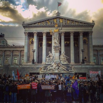Most days, the street in front of the Austrian parliament is filled with tourists taking pictures of the archittecture, but on this blustery early spring evening, thousands demonstrated against a proposed government crackdown on refugees.