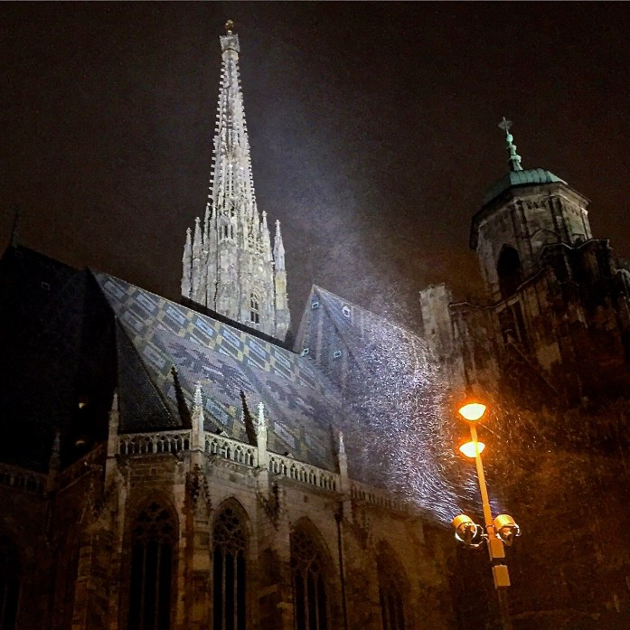 Snowfall starts around the Stephansdom in Vienna.