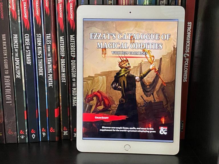 Ezzat's Catalogue of Magical Oddities on iPad on bookshelf.
