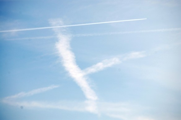 Sky designs being created as a jet leaves its mark in the fray