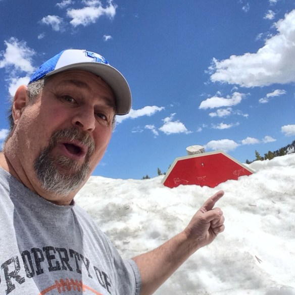 "Almost didn't see the stop sign covered in snow at the ""Top of the World Store"" in the Beartooth Range at 10,000 feet in May 2014"