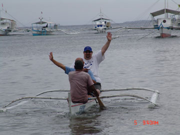 Sumoflam squeezed into an outrigger canoe on a small island north of Cebu.