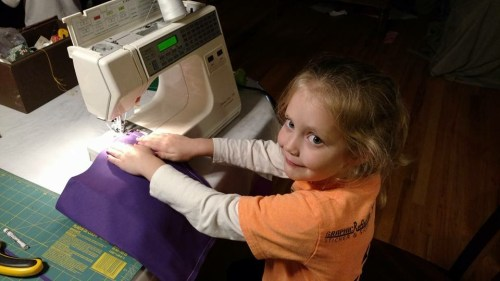 Livvy loves to learn new things. Learning to sew at age 5